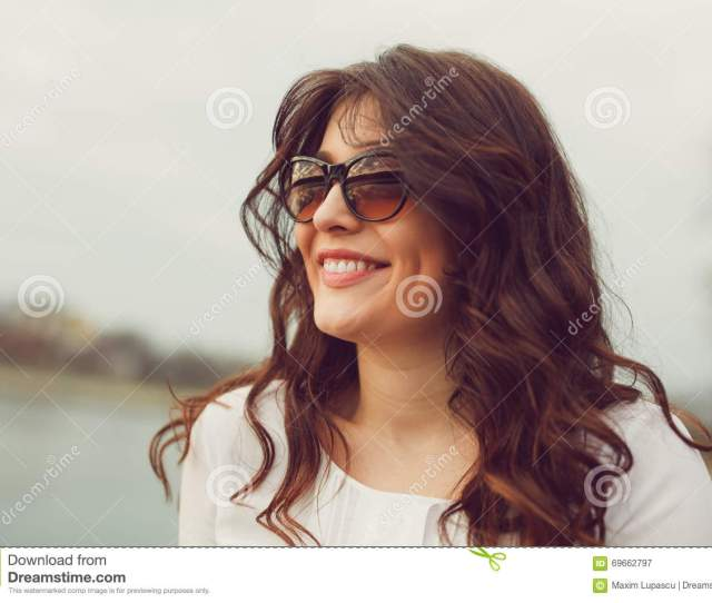 Young Gorgeous Brunette Woman Wearing Sunglasses