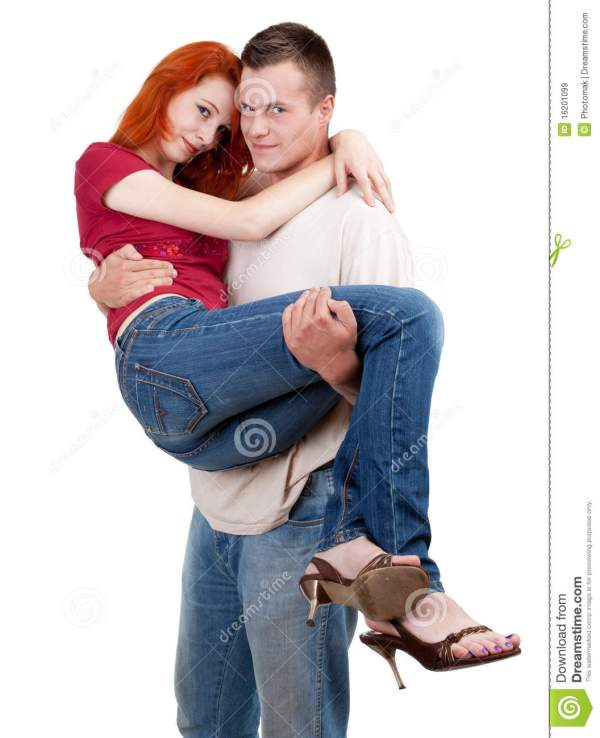 Young Man Carrying Girlfriend In His Arms Royalty Free ...