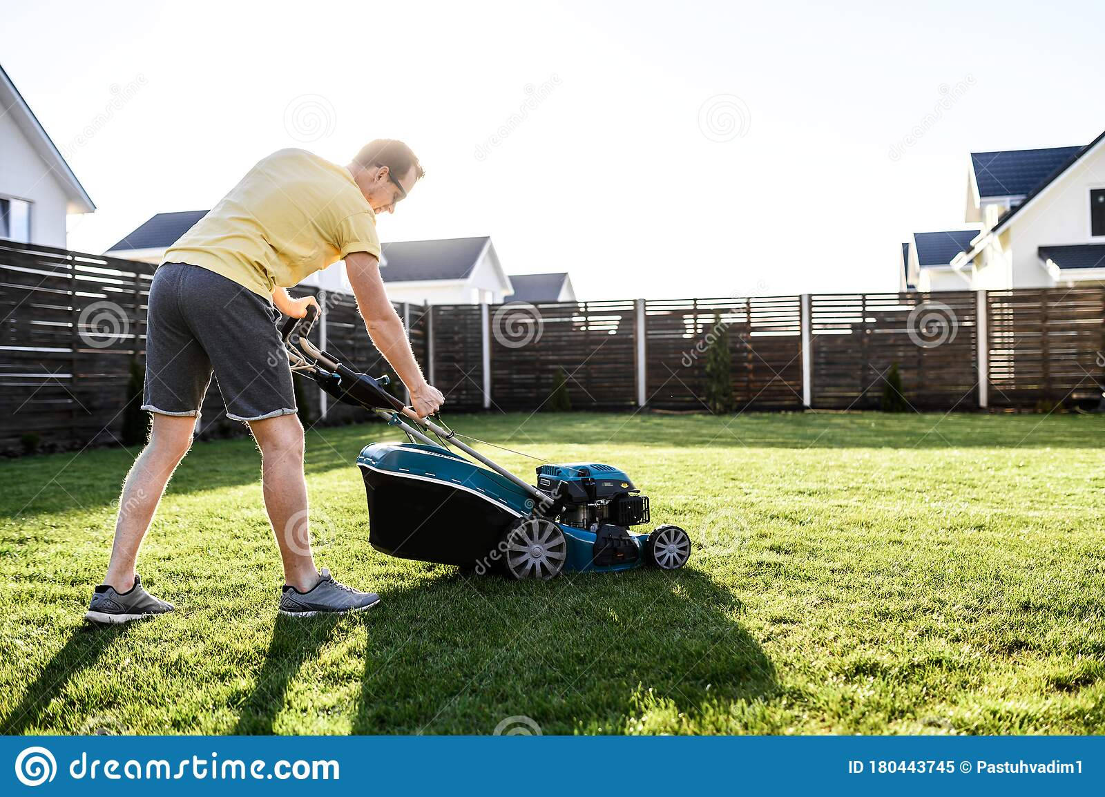 A Young Man Is Going To Mow The Lawn Stock Image Image Of Growing Casual 180443745