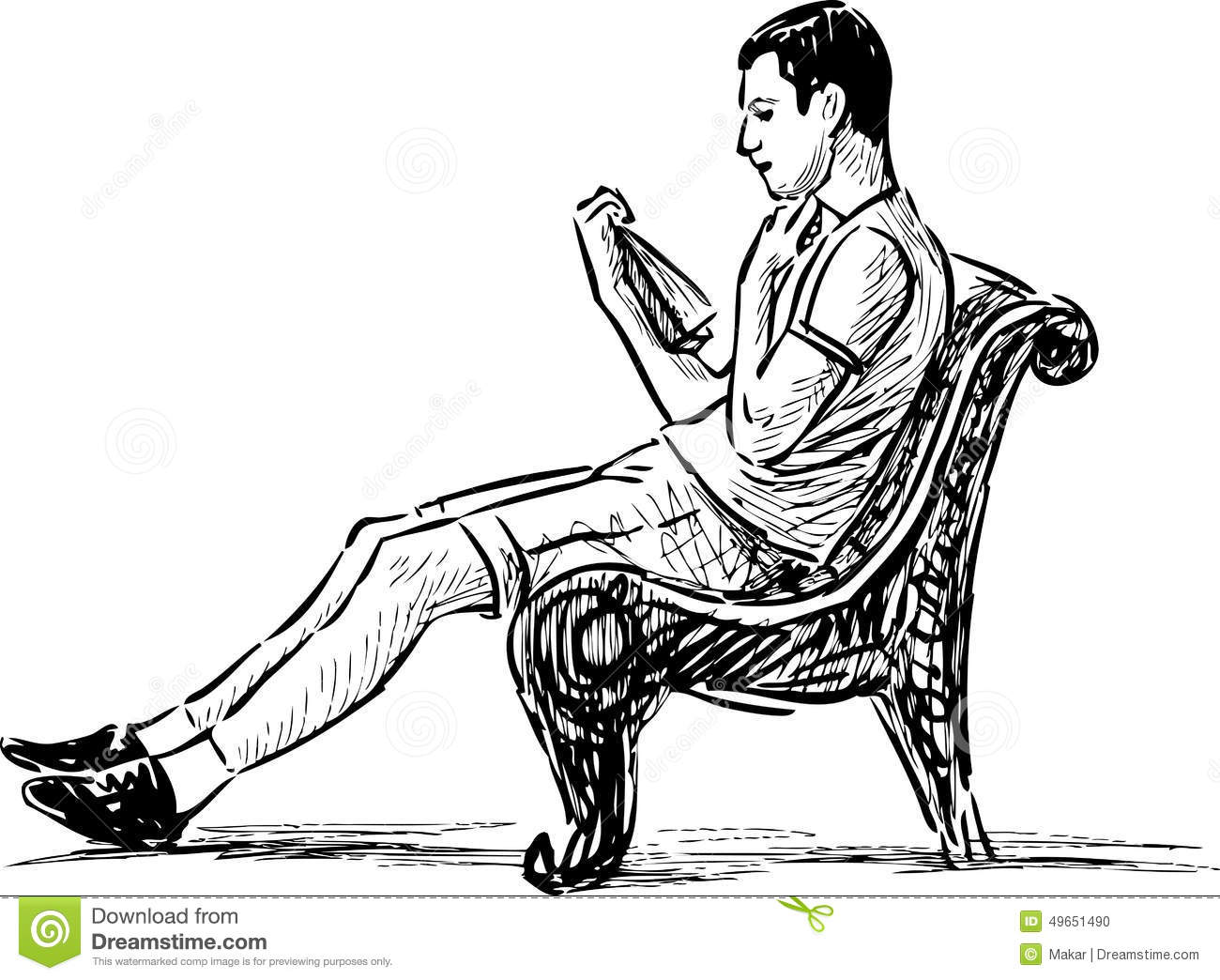 Young Man Reading On A Park Bench Stock Photo