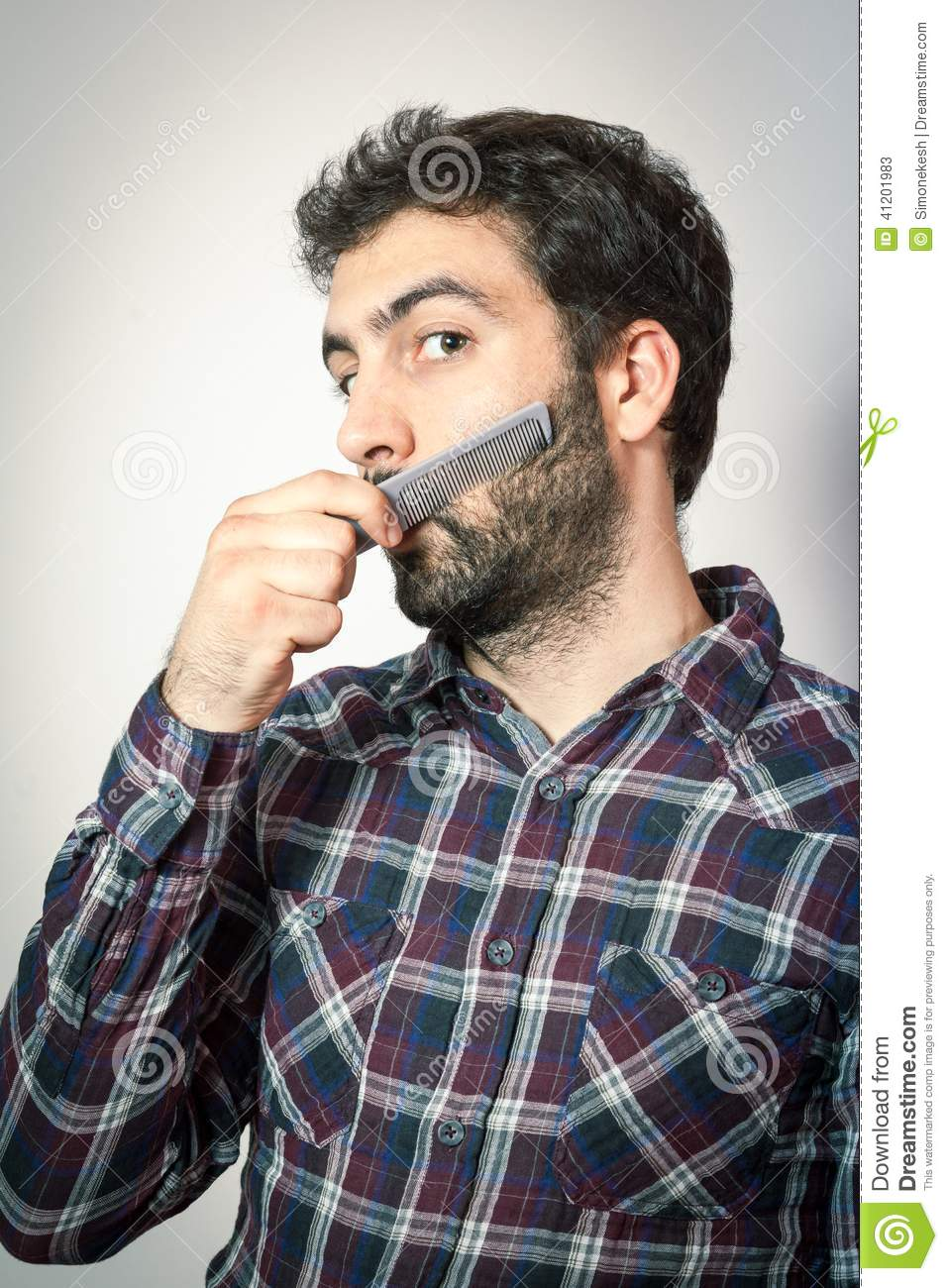 Young Man Want Comb His Beard And Moustaches Stock Image