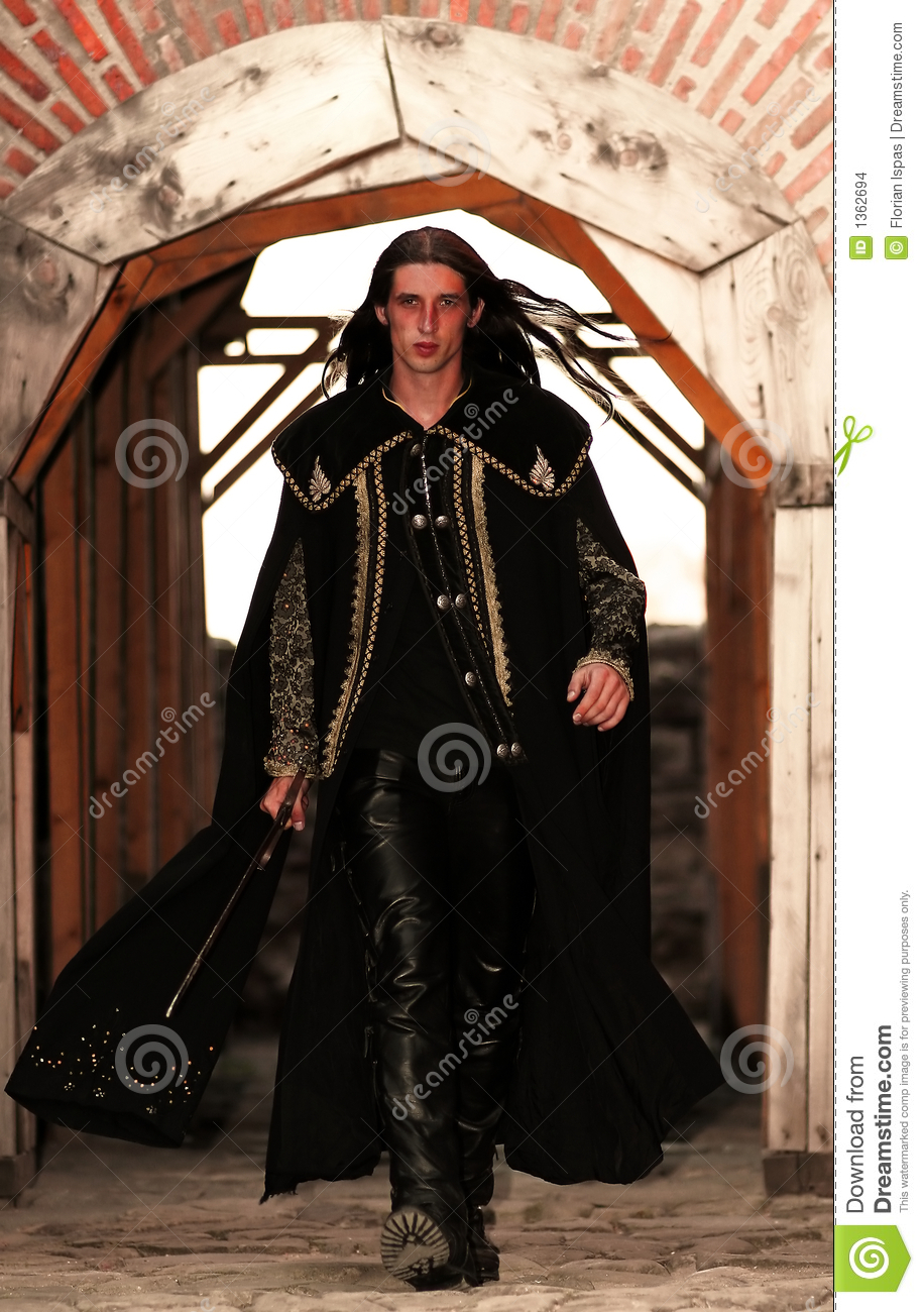Young Medieval Prince With Saber And Black Mantle Stock