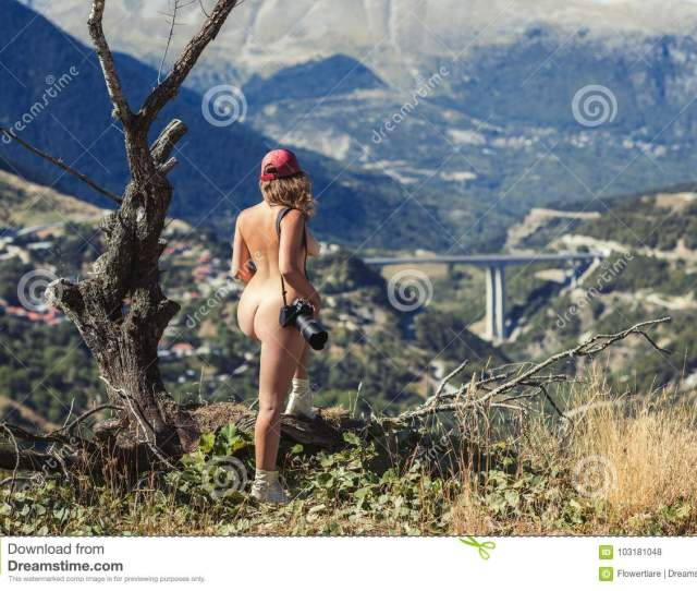 Young Female Photographer With Professional Camera Near Big Old Tree Opposite Greek Village A Girl With Camera Opposite The Village Of Metsovo In Greece On