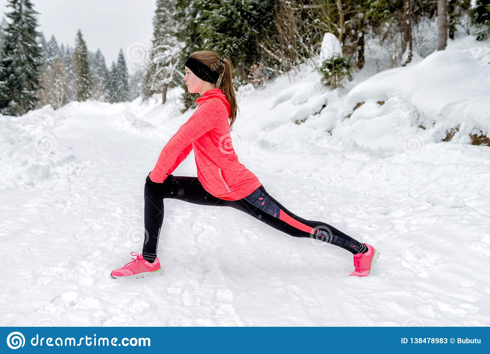 Young Sport Woman Doing Exercises During Winter Training