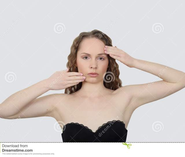 Beauty Health Make Up And Skin Care Concept Young Woman Makes Facial Massage On Gray Background