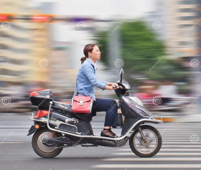 Young Woman On A Fast E Bike Kunming China