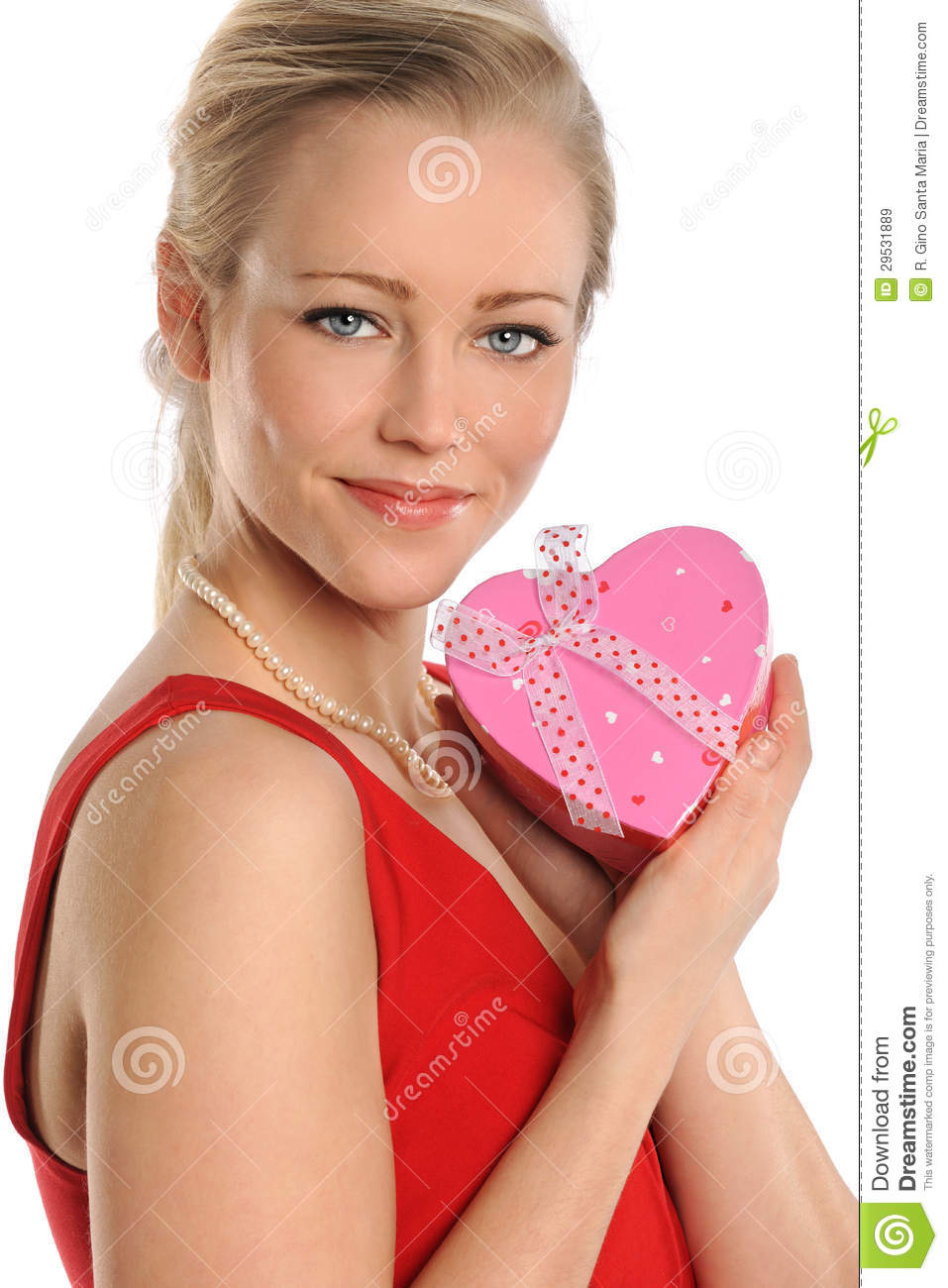 Happy Young Woman Holding Heart Shaped Gift Box Royalty