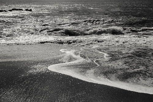 Wanneer het water het strand bereikt
