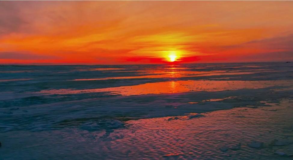 sunset-on-lake-ice - Walking on Clear Ice