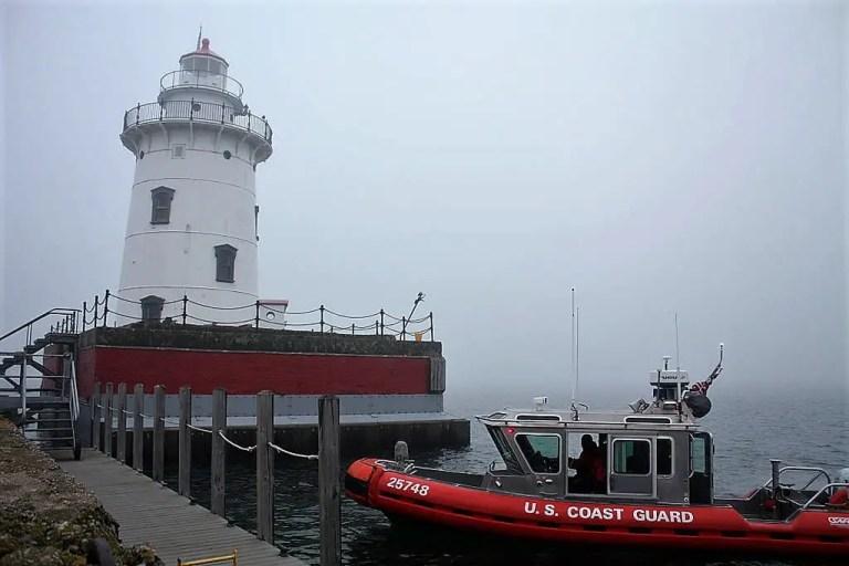 Harbor Beach Lighthouse with US Coast Guard