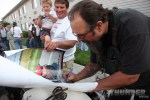 #69 Dave Kafton signs a poster for some fans