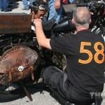 Teamwork: #58 Kris Thompson helps out fellow rider #80 Shinya Kumura