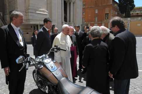 The Davidson family presents Pope Francis with his 2013 Harley-Davidson Dyna Super Glide