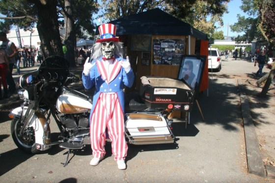 The Rip City Riders mascot poses with Chilly Billy's bike near the memorial display at the Petaluma Fairgrounds