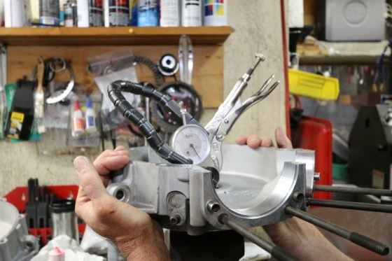 Using a dial indicator & dummy crank tool,  Ken checks the left-side Timken bearings for clearance