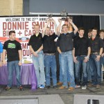 The MTI club onstage accepting awards from Donnie Smith