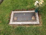 Memorial for Elvis' stillborn twin brother Jessie is placed next to the graves of Elvis, his parents and grandmother