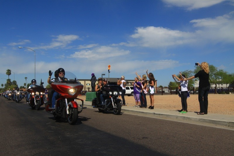 Guests of the Wildhorse Pass Casino and Hotel lined up to take photos of the 1200 Torch Riders arriving at the Phoenix Bike Fest