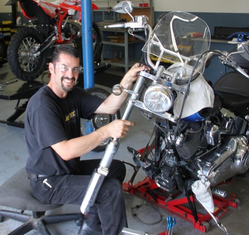 Tony Marasco working on the 2008 Softail Custom's forks