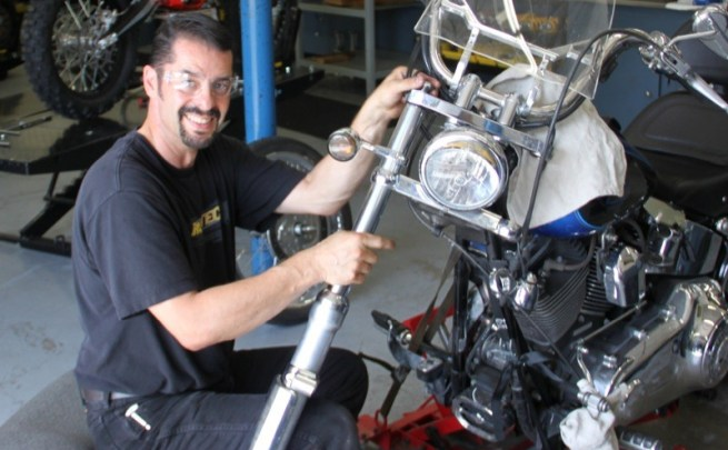 Tony Marasco working on the 2008 Softail Custom's forks