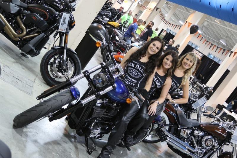 Jack Daniels' ladies riding three-up