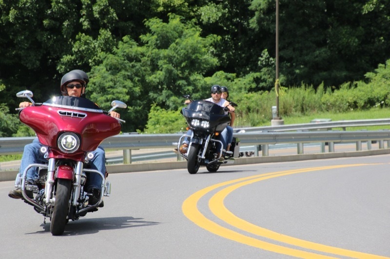 Bikers riding up the hill on the way into the festival
