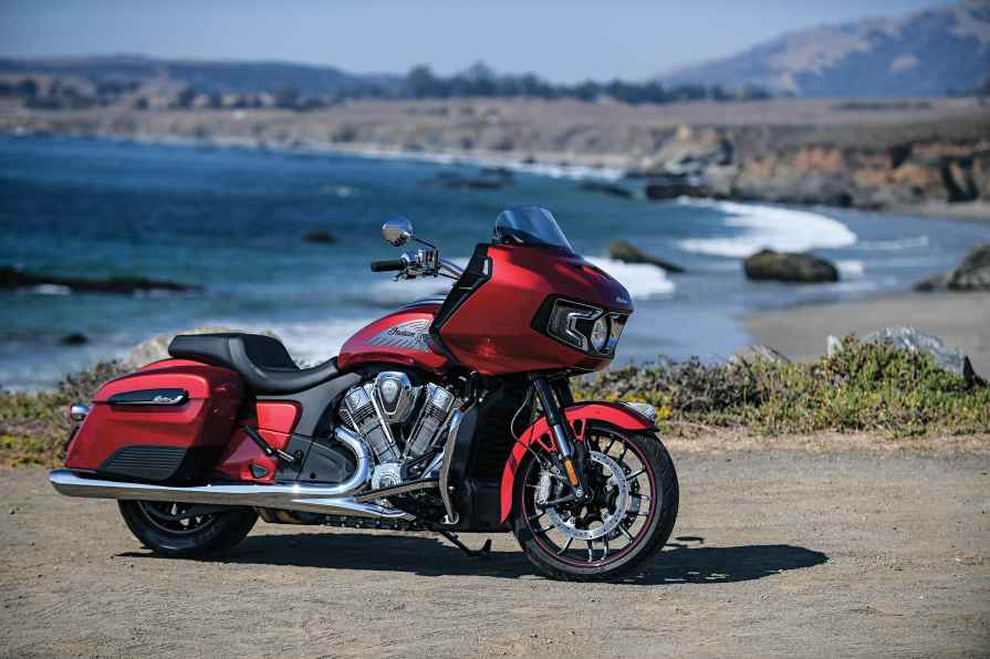 The 2020 Indian Challenger Limited is available in Thunder Black Pearl, Deepwater Metallic and Ruby Metallic (shown). All Challenger models get the protective plastic covers on the lower front of the top-loading saddlebags.