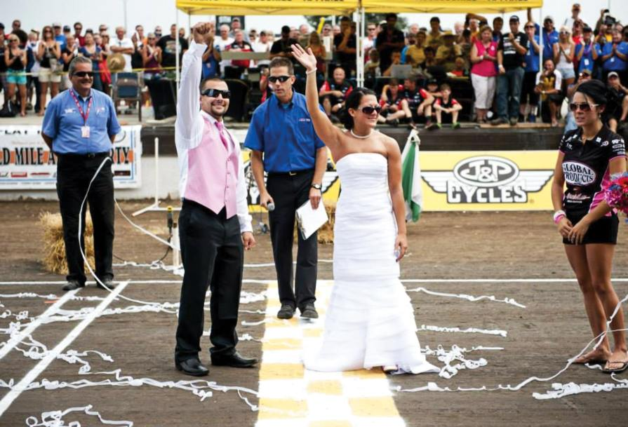 "Scottie Deubler (center) married the two at Springfield, and told us: ""We didn't have much of a rehearsal, but after practice and qualifying she put on a dress, Jared changed, and we did a short ceremony on the front straightaway."""