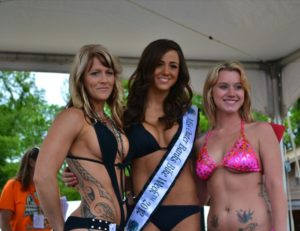 Sarah Thomas (center), winner of the Miss Outer Banks Bike Week Bikini Contest, with the two runners-up