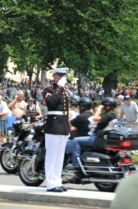 One of the two marines standing along 23rd Street, saluting the procession of bikes until the last one rumbles by