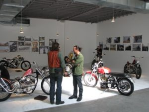 Canvas and iron art share the stage inside the Root Studio