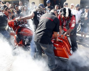 The burnout crew helps this hot-rodding Harley shred some rubber on the streets of Puerto Peñasco