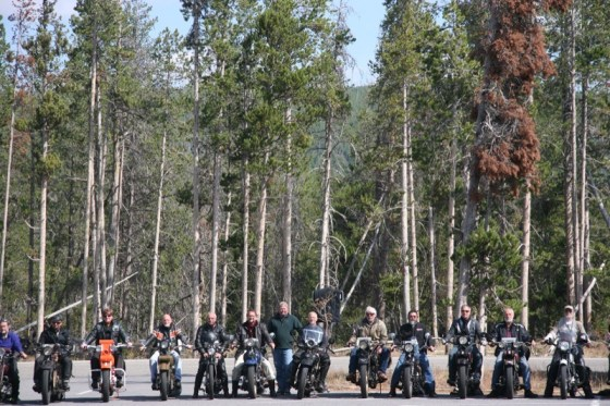 Lonnie Isam, Jr. (center) gathered with a few of the adventerous riders who braved the icy conditions in Yellowstone National Park as the group spent the day animal watching on their vintage iron