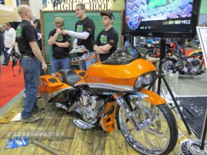 Members of the Sturgis Brown High School Student Build Challenge team sit at their display at the 26th annual Donnie Smith Bike Show