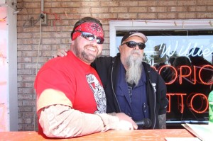 Emcee Roadside Marty and Tropical Tattoo proprietor Willie Jones preside over the day's events