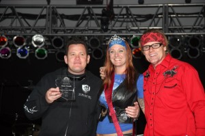 Nick Trask from Trask Performance is presented the 2013 Arizona Bike Week Hero Award from Miss ABW 2012 Shelly Rollins and emcee Jay Allen
