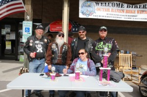 """Hippie from Heavens Saints MM in Myrtle Beach, Papa Smurf from OBX H.O.G., Nick McClintock from Barco, NC, and Kieth """"Katfish"""" from Rush Racing Products help Shamra Everette tally the votes in the Ladies Bike Show"""