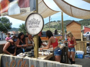 Ole Smoky Moonshine girls keep folks hydrated. I recommend the 'White Lightning' and the cherries...