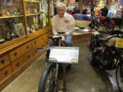 Mike Wilson sits atop Leo Payne's Sportster that Mike and his wife, Margaret, have on loan to the museum