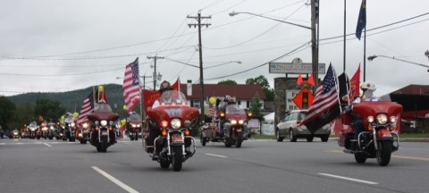 Members of the Fire Riders MC lead the Dunlop Bike Parade on Saturday