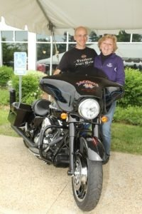 This 2013 Street Glide, custom painted to commemorate the rally's 90th anniversary, is being raffled off to benefit the Boys & Girls Clubs of the Lakes Region