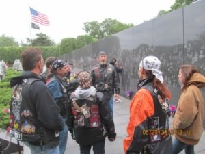 Visiting the Wall to remember and honor those who gave their lives in Vietnam