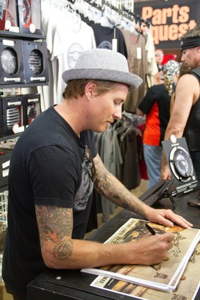 Bike builder Roland Sands kept busy talking to fans and signing posters