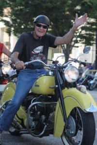 All smiles on State Street aboard a sweet vintage Indian
