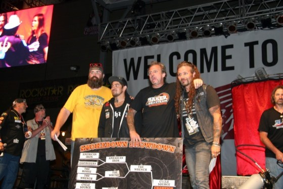 "Bert Baker of BAKER Drivetrain congratulates the top three winners of the Easyriders burnout contest. Chris Callen (r) from ""Cycle Source"" took first, ""Wrench"" magazine took second and Joe Mielke (l) represented ""Thunder Press"" for third place."