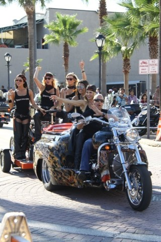 The Jägermeister trike escorts a bevy of beauties along with a self-contained bar down Main Street