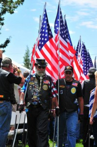Patriot Guard Riders march into Cripple Creek City Park with a parade of flags for the Remembrance Ceremony