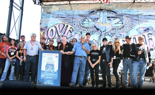 The Southern California Harley-Davidson Dealers Association presents Oliver Shokouh (far right) with a framed 30th anniversary Love Ride poster