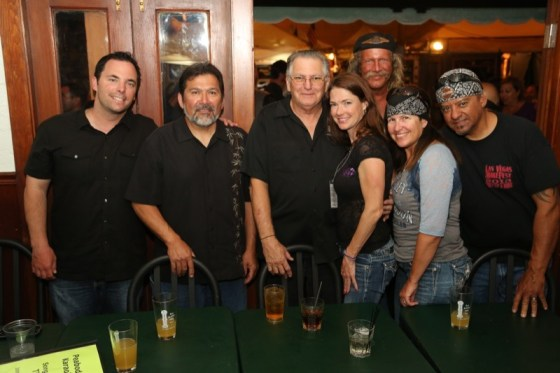 Clint August, Rudy Flores, Peabody's Café & Bar night manager Bob Smith, Reanon Willoughby, Brian Phelps, and Karen and John Padilla