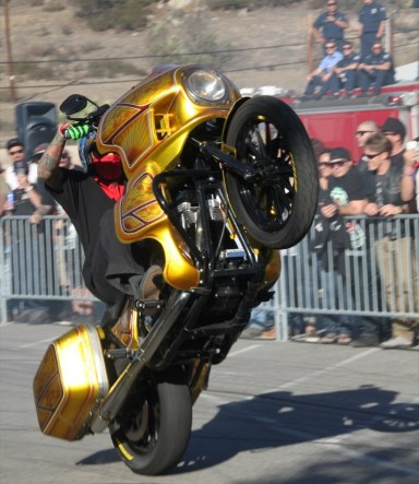 Unknown Industries rider Nick Leonetti performs a wheelie on his FXRT